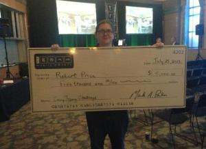 Robert Price with his $5000 typing prize